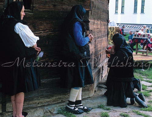 Old womens praying in front of the church